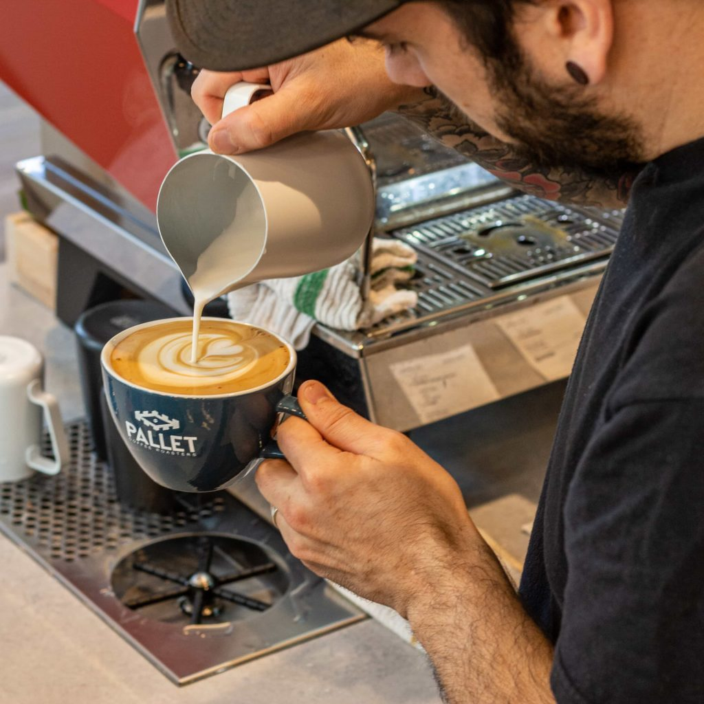 Latte Being Poured at Pallet Coffee Roasters (Downtown)