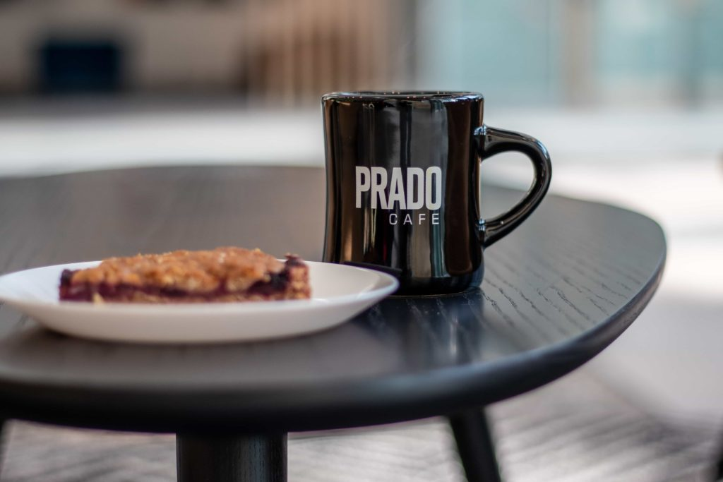 Drip coffee and pastry on table at Prado Burnaby